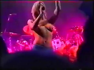 Courtney Love topless onstage