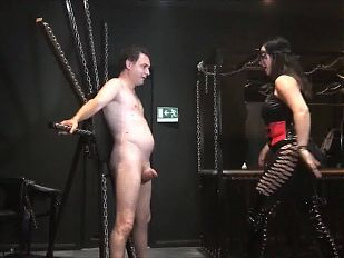 Mistress slides while kicking hard a pair of balls!!!