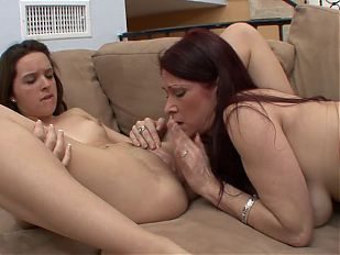 Mature bitch in stockings sits on young brunette's face