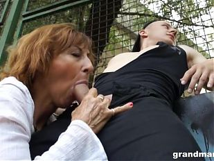 Mom sucks cock on playground