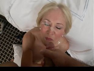 Blonde MILF takes messy facial.mov