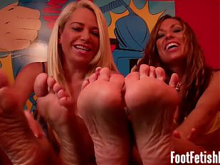 Worship our big sexy feet